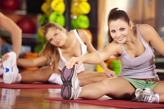 Girls-Stretching-in-Gym